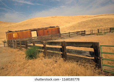 KERN COUNTY, CA - AUGUST 30, 2018: A railroad boxcar is serving as a storage shed next to a corral on a California ranch in the foothills of the Sierra Nevada mountain.