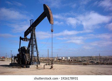 KERN COUNTY, CA – FEBRUARY 27, 2021: This oil well pumping unit is part of the vast Kern River Oil Field northeast of  Bakersfield, California.
