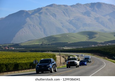 KERN COUNTY, CA - JANUARY 24, 2019: Motorists travel along California State Route 178 between the Central Valley  and the  dangerous Kern River Canyon, through orange groves and vineyards.