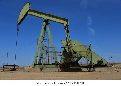 KERN COUNTY, CA - JULY 21, 2018: Crude oil is pumping from a Central California well. It has high viscosity and is usually heated with secondary recovery techniques.