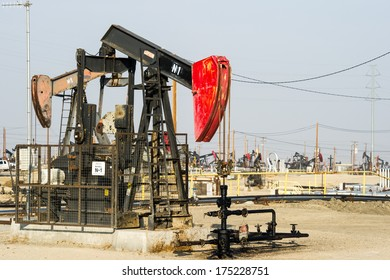 KERN COUNTY, CALIFORNIA - NOVEMBER 26, 2013: Pumpjacks extract oil from an oilfield in Kern County, CA. About 15 billion barrels of oil could be extracted using hydraulic fracturing in California.