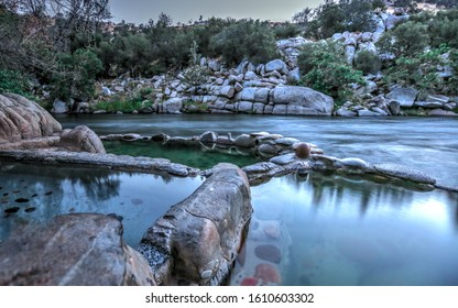 Kern River, California - February 2019: Remington Hot Springs is a collection of naturally warm manmade pools set along the edge of the Kern River.