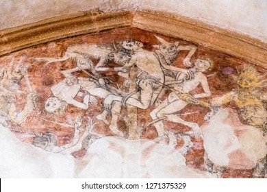 KERNASCLEDEN, FRANCE - Aug 7, 2018: Medieval frescoes at the Eglise Notre Dame de Kernascleden, representing death and the purgatory