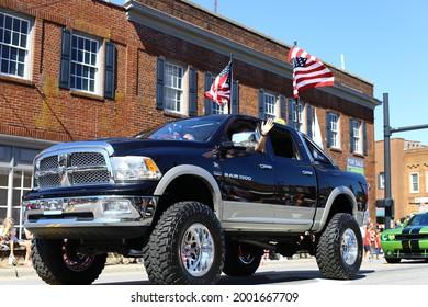 Kernersville, North Carolina United States July 3, 2021: A big black Dodge Ram truck driving through Kernersville 4th of July parade