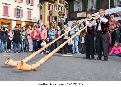 Kerns, Switzerland - 1 October 2016: People wearing traditional clothes and playing the alphorn at Kerns on the Swiss alps