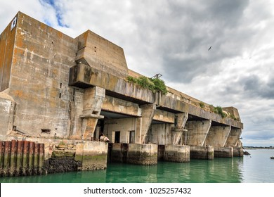 The Keroman Submarine Base structure K3, a WWII German U-boat facility, in Lorient, France, in summer with a beautiful cloudscape