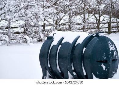 Kerosene heating oil tank covered in snow.