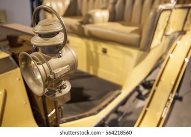 Kerosene lantern on classic on classic car with fresnel lens. Closeup