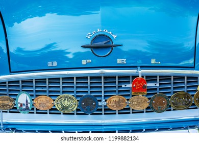 Kerpen, Germany - August 19, 2018: front view of a classical Opel car with rallye badges on the radiator. Opel is a German automobile manufacturer