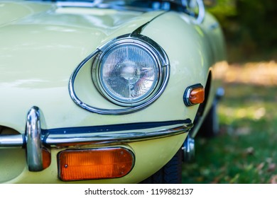 Kerpen, Germany - August 19, 2018: head light of a Jaguar E-Type. Jaguar E-Type is a British sports car, manufactured from 1961 to 1975. This the model was an icon of the motoring world
