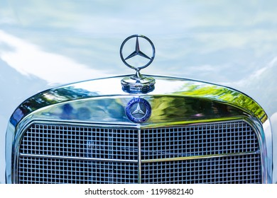 Kerpen, Germany - August 19, 2018: front view with Mercedes star of a classical Mercedes-Benz. It's a global automobile marque and division of the German company Daimler AG, known for luxury vehicles