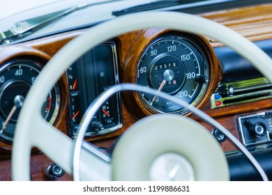 Kerpen, Germany - August 19, 2018: steering wheel and dashboard of a classical Mercedes-Benz. It's a global automobile marque and division of the German company Daimler AG, known for luxury vehicles