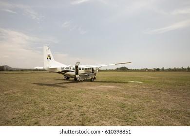 Kesese, Uganda - February 22, 2017 : AeroLink plane on dirt runway of Kesese, Uganda.