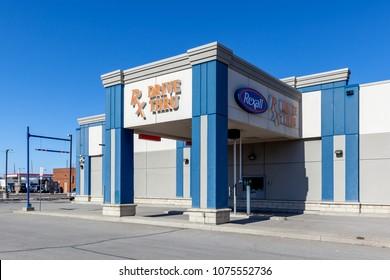 Keswick, Canada - April 22, 2018: Rexall Drugstore drive thru. Rexall Drugstore is a chain of pharmacies in Canada,