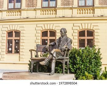 Keszthely, Hungary - February 05, 2020: Statue of Count Gyorgy outside Franciscan Church on Foe Square. Keszthely, Hungary