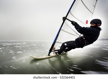 Keszthely, Hungary - February 11, 2012: Hungary's Zsombor Berecz olympics sailor (Beijing, London) ice surfing on the Lake Balaton.