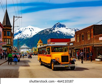 Ketchikan, AK, USA - May 24, 2016:  Downtown Skagway bustles with cruise passengers enjoying the natural beauty and the transportation options.
