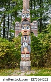 Ketchikan, Alaska - September 30, 2017: Kadjuk Bird Totem Pole at Totem Bight State Historical Park, Ketchikan, Alaska. Native American tradition. Totem animals act as guardian spirits.
