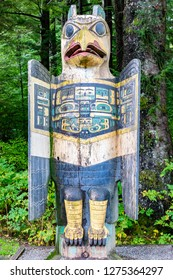 Ketchikan, Alaska - September 30, 2017: Eagle Grave Marker Totem Pole at Totem Bight State Historical Park, Ketchikan, Alaska. Native American tradition. Totem animals act as guardian spirits.