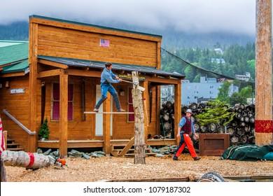 Ketchikan, Alaska, USA - 6/11/03. Lumberjacks demonstrate  their skills at tourist show in Alaska.
