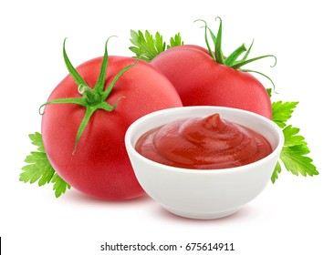 Ketchup in bowl and two fresh tomatoes isolated on white background