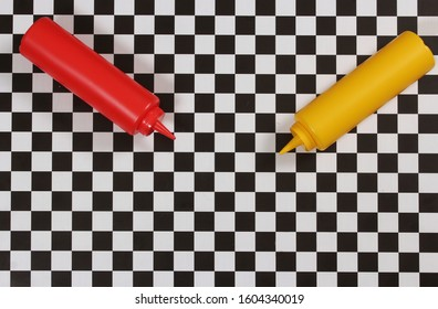 Ketchup and Mustard Bottles on Checkered Table
