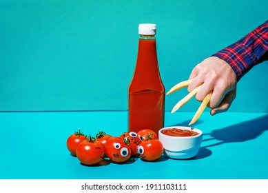 Ketchup sauce with fresh tomatoes on a blue background. toning. selective focus