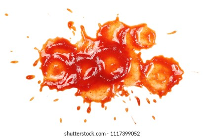 Ketchup spreading, splashes isolated on white background, tomato pure texture, top view