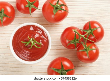 ketchup or tomato sauce on a wooden background