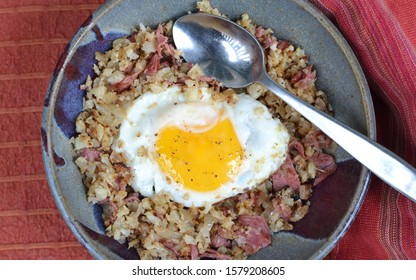 Keto Breakfast Bowl; Cauliflower and corned beef hash, topped with fried egg