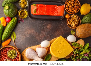 Keto diet concept. Ketogenic diet food frame. Balanced low-carb food background. Vegetables, fish, meat, cheese, nuts on a dark background.