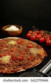 Keto Diet Pizza with Low-Carb Tortilla, Sugar-Free Tomato Sauce, Ground Beef, Cherry Tomatoes and Mozzarella