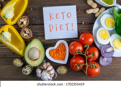 Keto diet. Vegetables and nuts are lined in the shape of a circle, inside a sticker with text KETO DIET. Top views clear space.