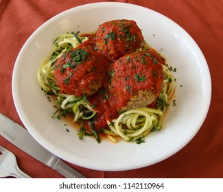 Keto friendly healthy meal. Lentil Protein Ball meal with zucchini noodles and red sauce.