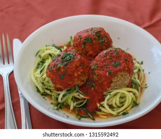 Keto friendly meal of lentil protein ball marinara with zucchini noodles