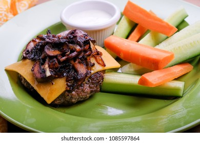 keto hamburger meal with cheese, mushrooms and vegetables, a ketogenic diet meal