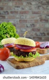 Keto Hamburgers with Grain-Free, Almond Flour and Egg Burger Buns, Low-Carb Beef Patties, Sugar-Free Hot Sauce and Vegetables