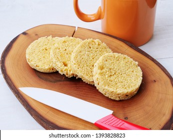 Keto mug bread. Sliced almond flour or coconut flour ketogenic bread baked in microwave over wooden board