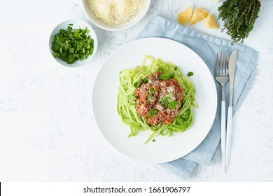 Keto pasta Bolognese with mincemeat and zucchini noodles, fodmap, lchf, low carb, ketogenic diet. Top view, copy space. Clean eating, balanced food.