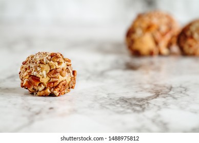 Keto pumpkin pie fat bombs. Made with pumpkin, pecan nuts, coconut oil and other fats..Selective focus with blurred background. Ketogenic diet concept