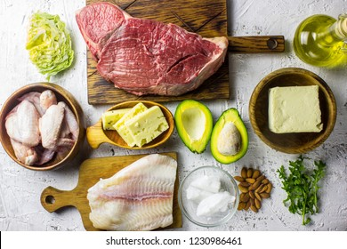 Ketogenic diet food. Balanced low-carb food background. Fish, meat, cheese, nuts on a white background. Healthy balanced food with high content of healthy fats. Diet for the heart and blood vessels.