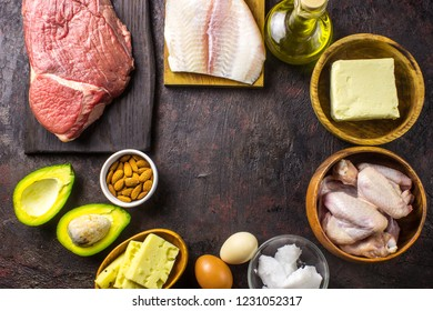 Ketogenic diet food. Balanced low-carb food background. Fish, meat, cheese, nuts on a dark background. Healthy balanced food with high content of healthy fats. Diet for the heart and blood vessels.