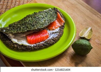 Ketogenic diet lunch break sandwich with spinach bread and salmon fish saturated fats vegetarian food omega 3 cooking seafood healthy snacks food close up