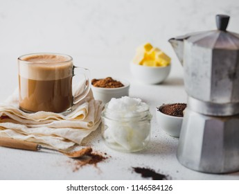 KETOGENIC KETO DIET DRINK. Coffe and cacao blended with coconut oil. Cup of bulletproof coffe with cacao and ingredients on white background.