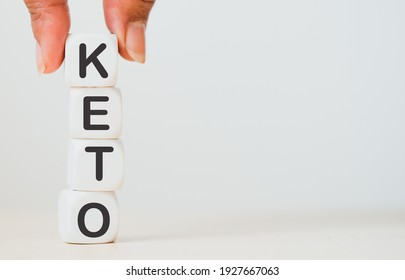 Ketogenic or KETO word on dice cube on white background.Keto, Ketogenic diet, low carb, Diet plan for change body with food.Healthy food Lifestyle.Wellness health.Ketones.Chance for Change body.