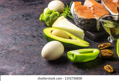 Ketogenic low carbs diet concept. Healthy balanced food with high content of healthy fats. Diet for the heart and blood vessels. Organic ingredients, black background, selective focus