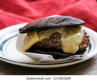 ketogenic portobello mushroom burger topped with cheddar cheese