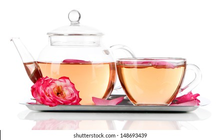 Kettle and cup of tea from tea rose on metallic tray isolated on white