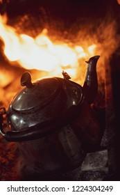 kettle on fire at Iraqi tea seller in Karbala, Iraq