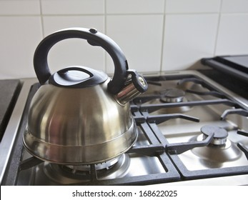 Kettle on a gas stove int a kitchen, home